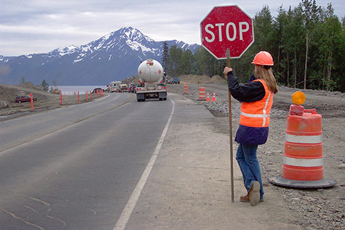 Flagger holding stop sign in construction zone